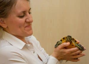 veterinarian Mindy holding a turtle